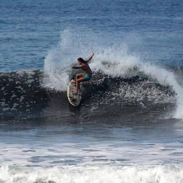 Molli Miller Surfing Turn