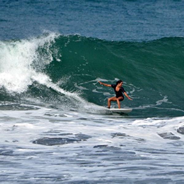 Molli Miller Surfing